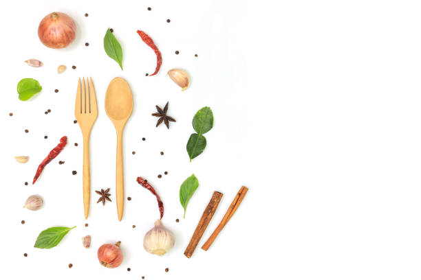 wooden spoon and fork on white background, decorate with dried chili, garlic, onion, cinnamon, black pepper, basil leaf, lime leaf and star anise in top view. copy space wooden spoon and fork on white background, decorate with dried chili, garlic, onion, cinnamon, black pepper, basil leaf, lime leaf and star anise in top view. copy space star anise on white stock pictures, royalty-free photos & images