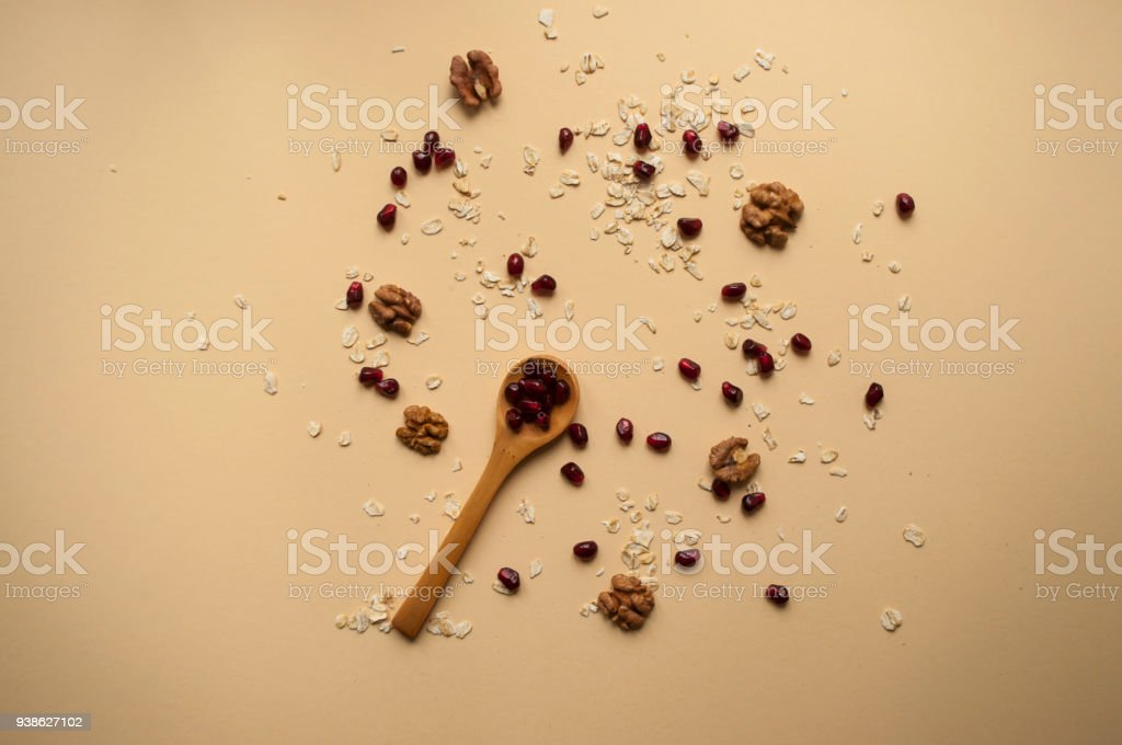 Wooden spoon and healthy breakfast ingredients around. stock photo