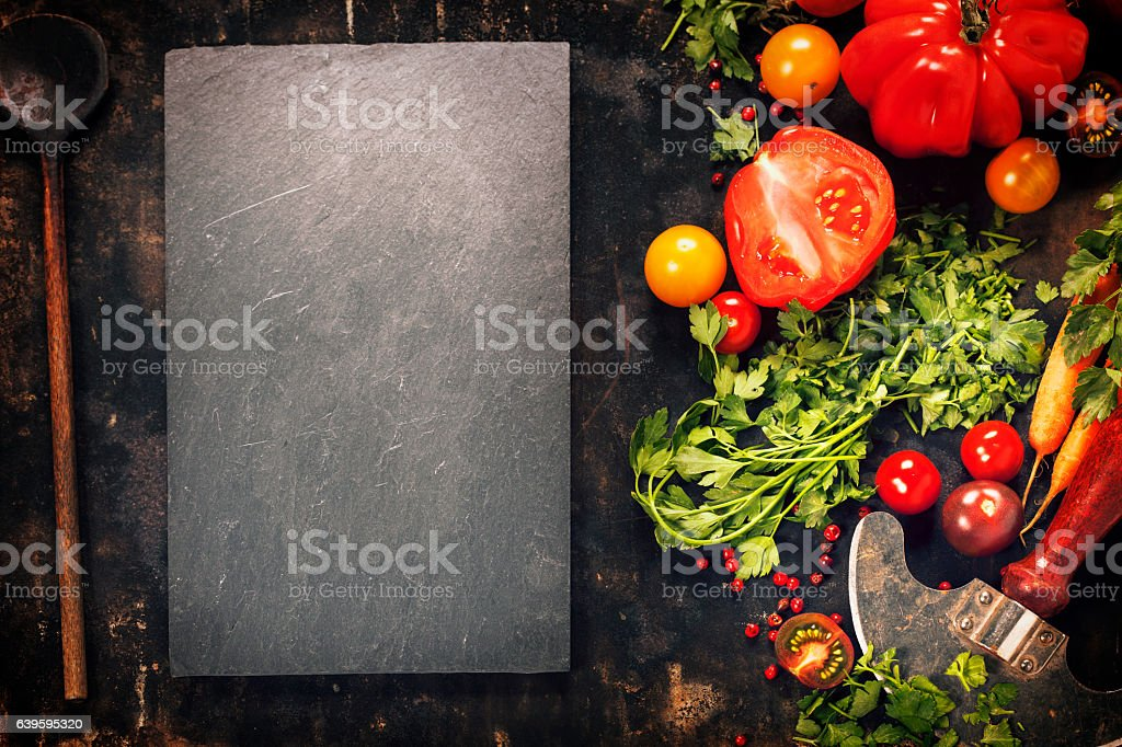 Wooden spoon and ingredients on dark background stock photo