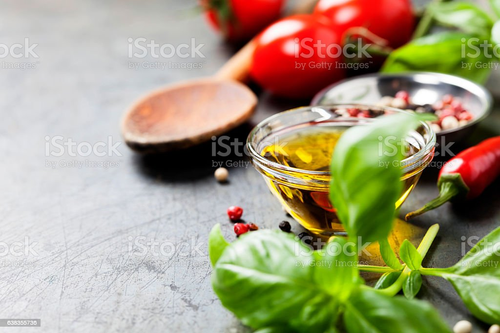 Wooden spoon and ingredients on old background stock photo
