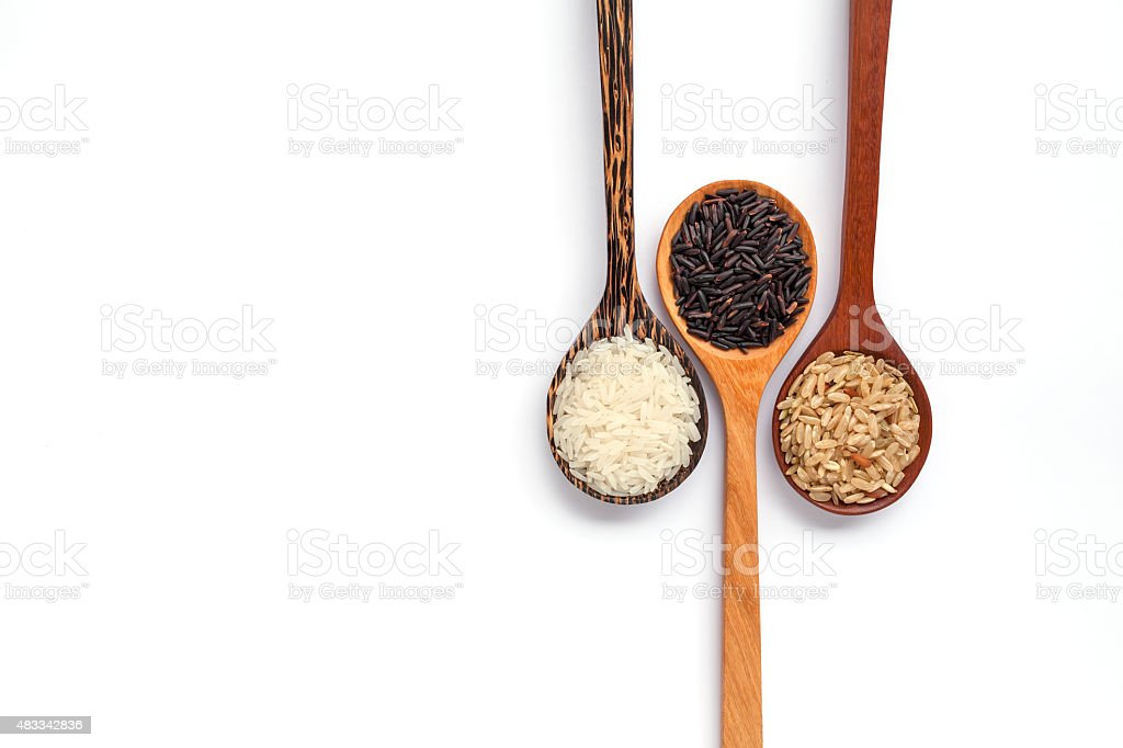 Wooden spoon and thai organic rice stock photo