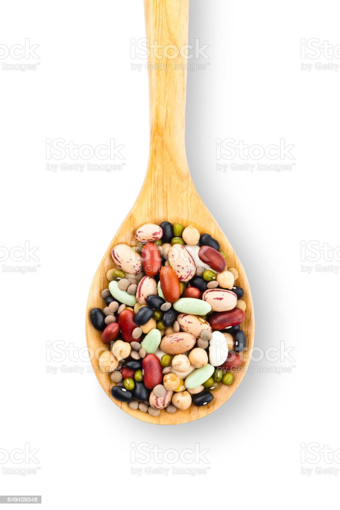 Wooden spoon filled with mixed beans stock photo