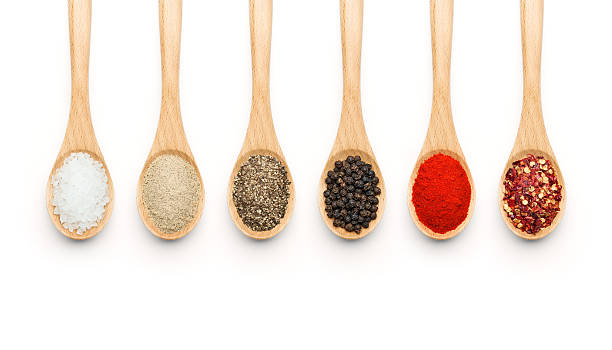 Wooden Spoon filled with various spices stock photo