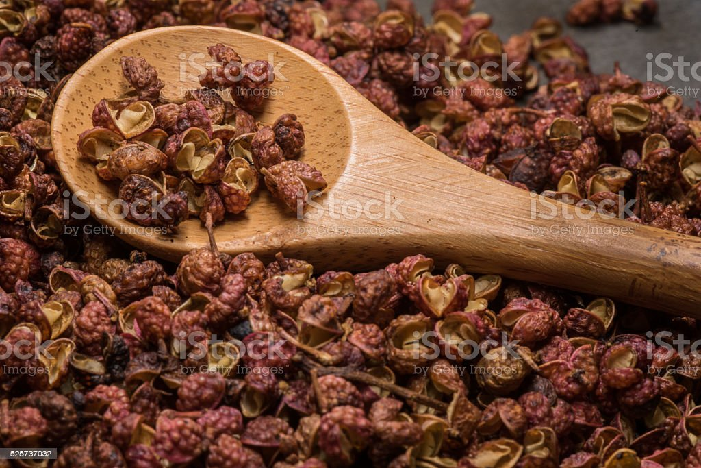 Wooden Spoon in Szechuan Peppercorns stock photo
