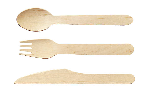 Wooden spoon, knife and fork stock photo