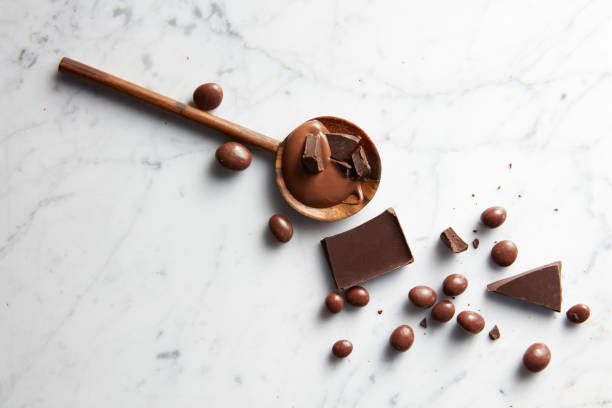 wooden spoon with chocolate - nusskekse stock-fotos und bilder