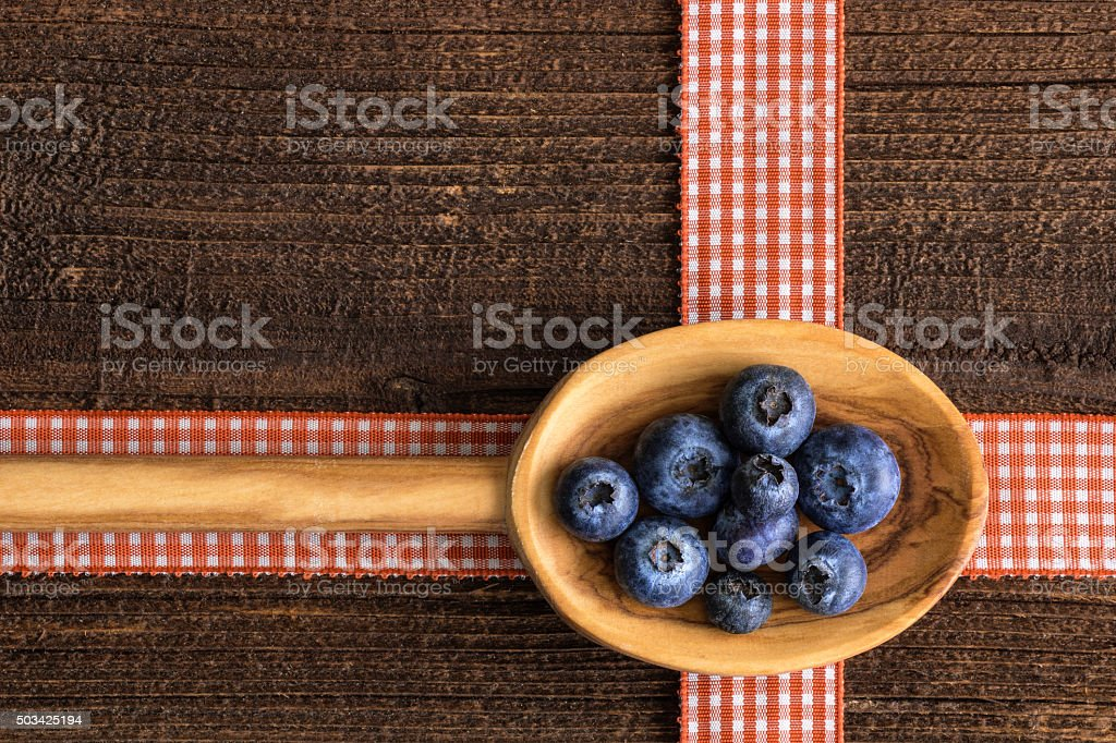 Wooden spoon with fresh blueberry stock photo