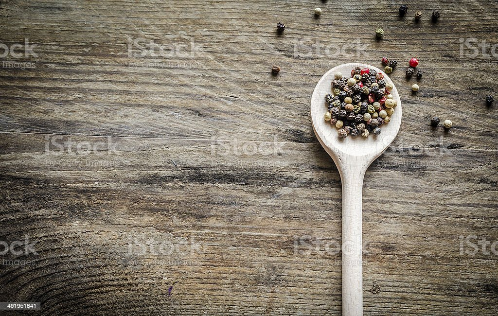 Wooden spoon with pepper stock photo