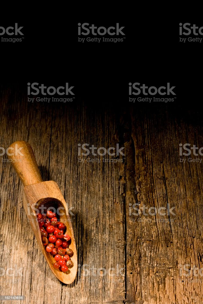 Wooden spoon with pink pepper. royalty-free stock photo