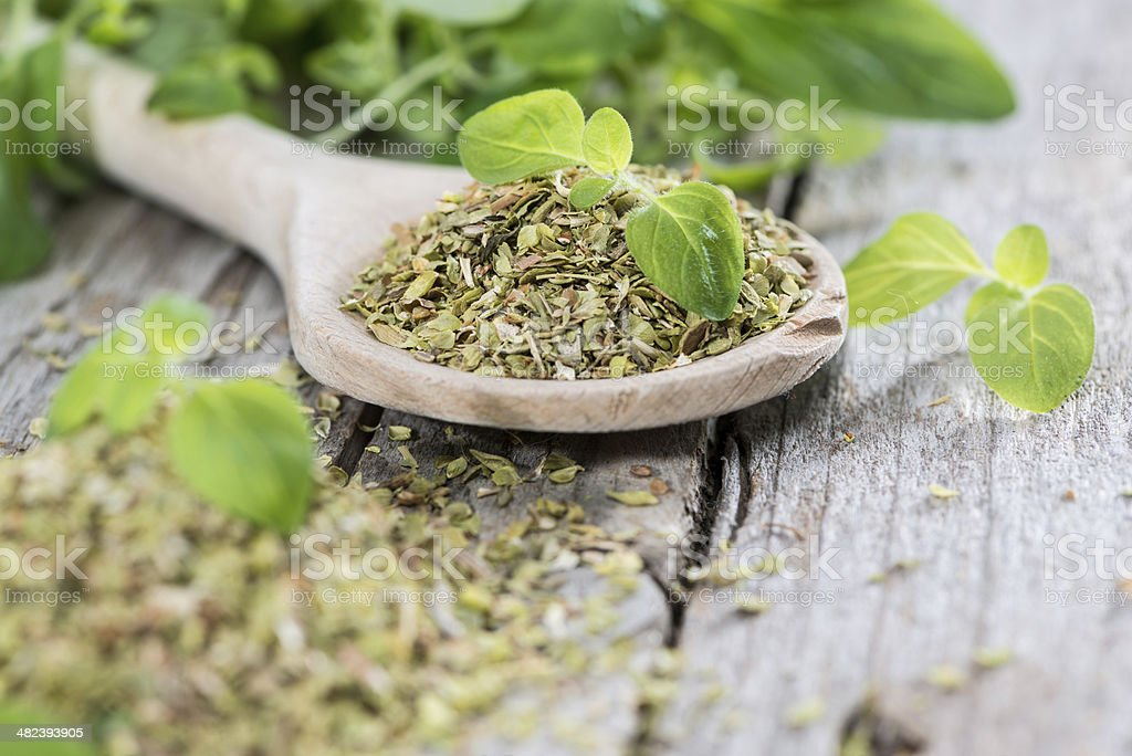 Wooden Spoon with shredded Oregano stock photo