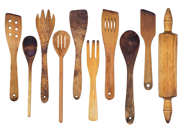 wooden spoons, spatulas and a rolling pin - keukengereedschap stockfoto's en -beelden