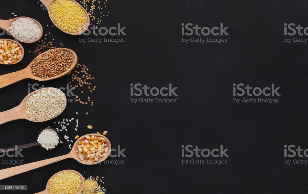Wooden spoons with various gluten free seeds stock photo