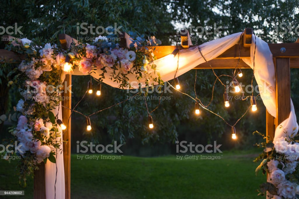 wooden square and floral decorations stock photo