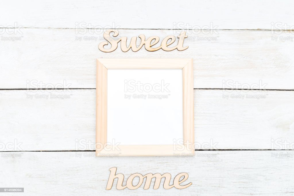 Wooden Square Frame And Wooden Inscription Sweet Home Mock Up Stock