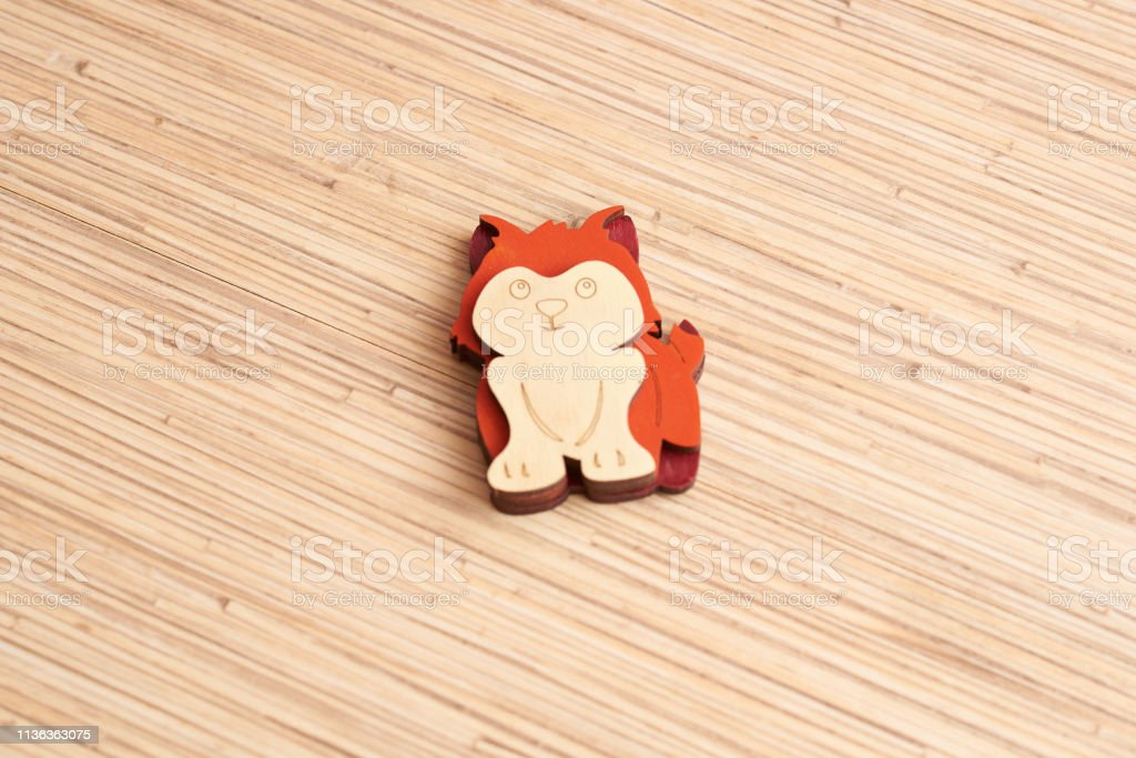 wooden squirrel magnet on table stock photo