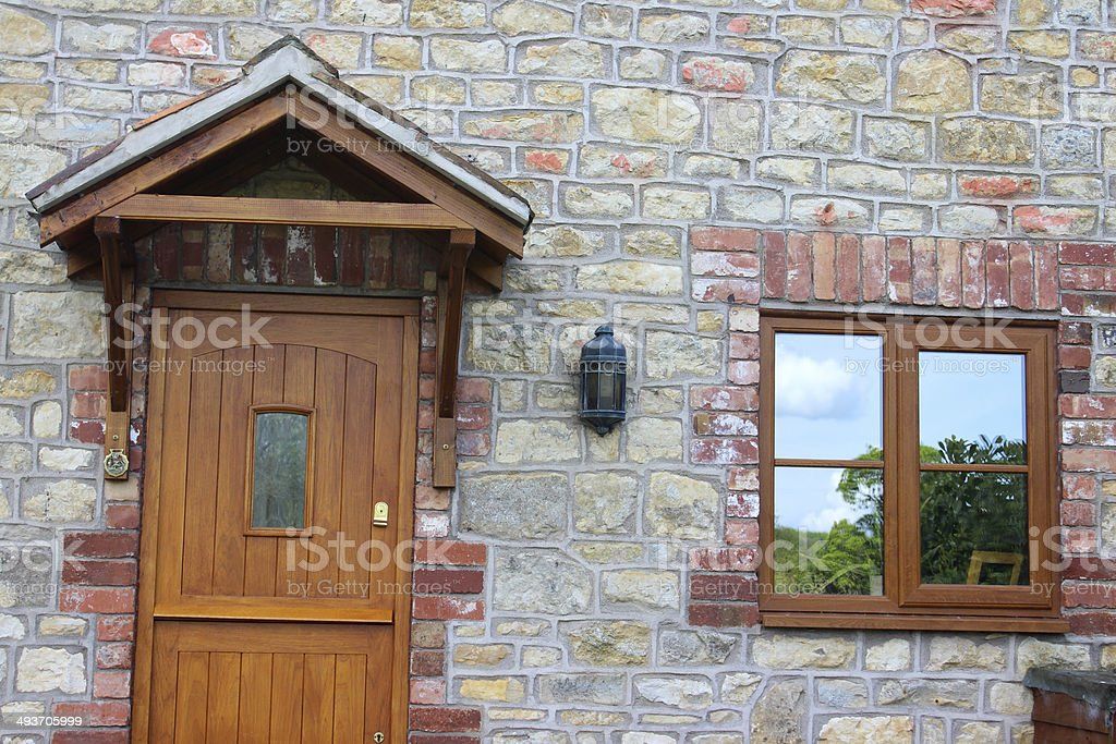 Wooden Stable Door On Stone Cottage House, With Porch Roof Royalty Free  Stock Photo