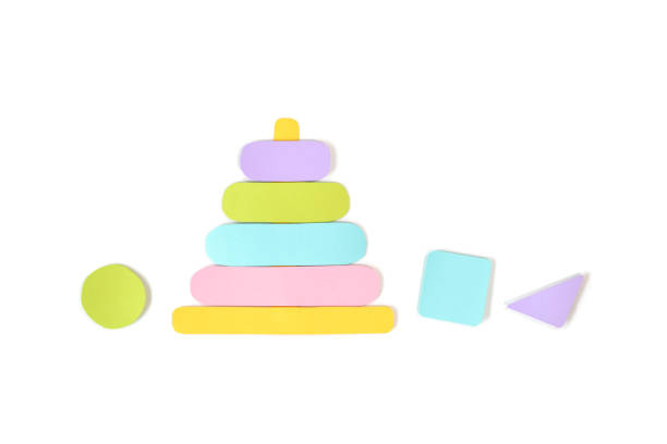 Wooden stacking ring toy paper cut on white background stock photo