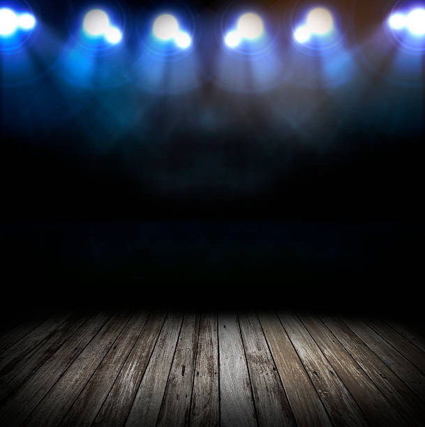 A wooden stage with floodlights stock photo