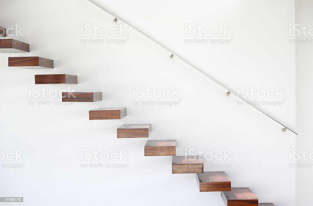 Wooden staircase and handrail stock photo