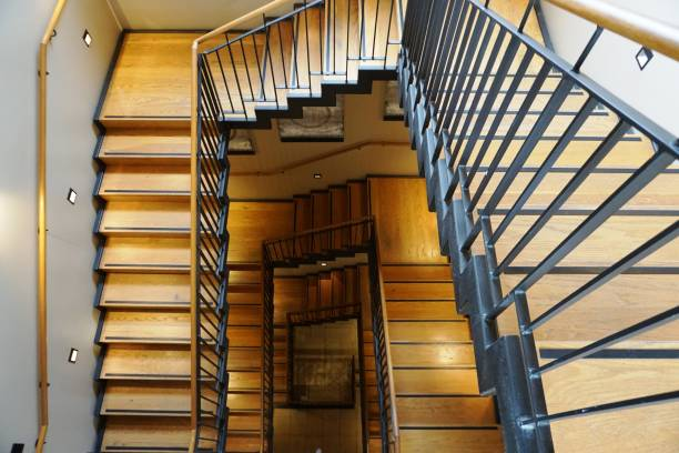 Wooden staircase in a high tower with many steps stock photo