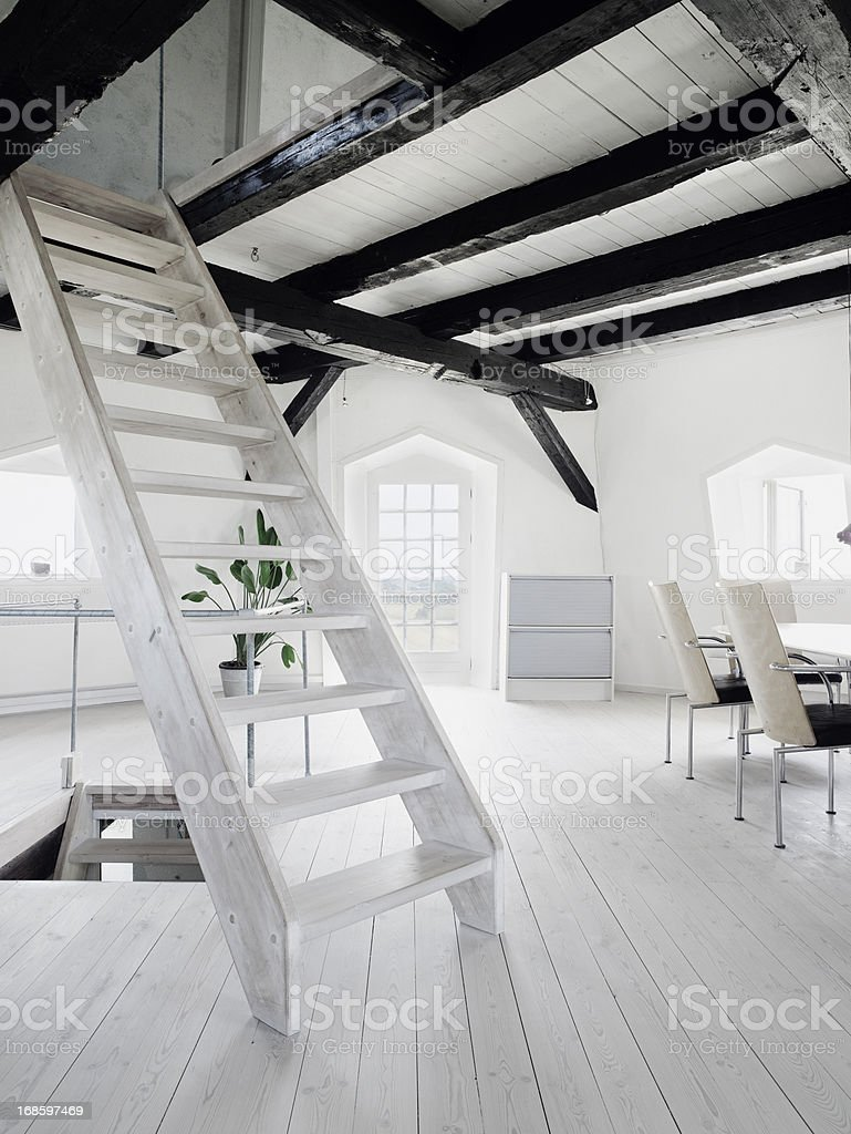 Wooden staircase in loft of old windmill stock photo