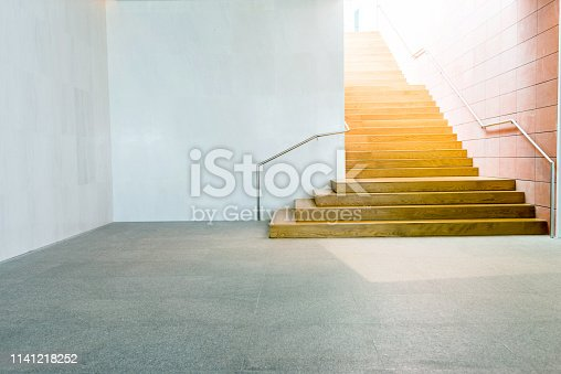 Wooden staircase in public building.