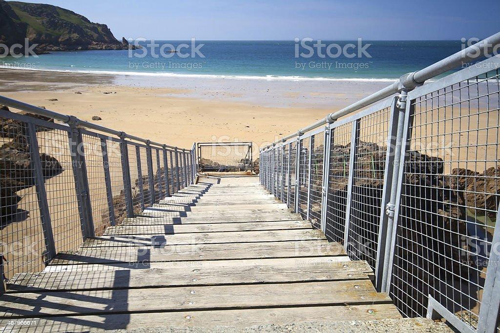 Wooden staircase to Greve de Lecq Beach, Jersey, UK stock photo