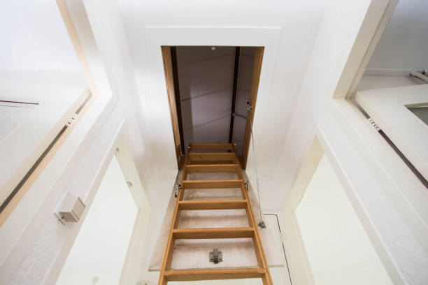 Wooden staircase to the attic in a modern house Wooden staircase to the attic in a modern house empty attic stock pictures, royalty-free photos & images