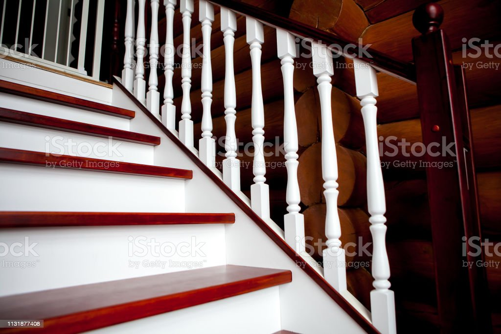 Wooden staircase with white steps in a wooden house Child protection