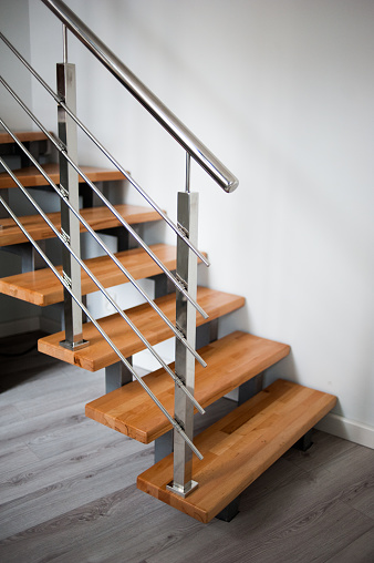 Wooden stairs and metal handrails