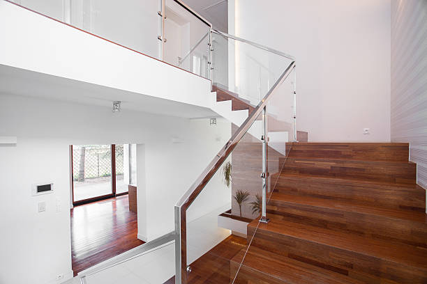 Wooden stairs with elegant balustrade stock photo