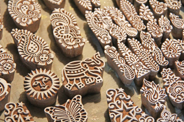 Wooden stamps printing blocks hand carved by artisans in India. Henna stamps for decorating the body or clothes, India. Wooden stamps printing blocks hand carved by artisans in India. Henna stamps for decorating the body or clothes, India carving craft product stock pictures, royalty-free photos & images
