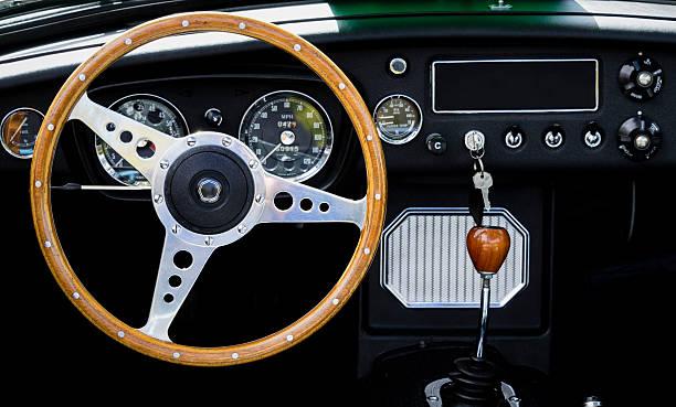 wooden steering wheel and interior of a classic car. - oldtimer veranstaltungen stock-fotos und bilder