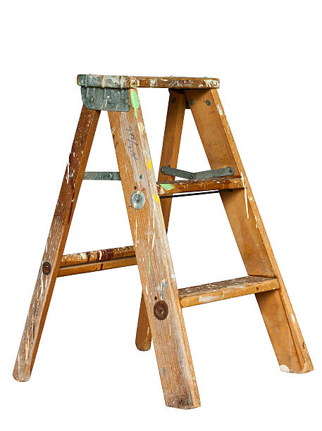 A wooden stepladder on a white background stock photo