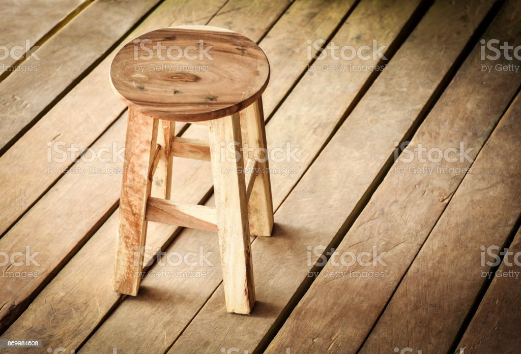 Wooden stool on wooden floor. stock photo