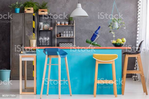 Wooden stools at kitchen island picture id902917554?b=1&k=6&m=902917554&s=612x612&h=3ao1c4xy99xlt3e g71fkq1x 6evs0bkklkvhk4oe7k=