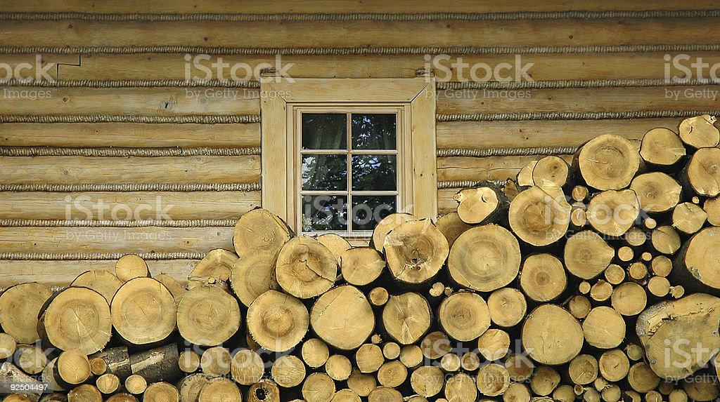 Wooden stumps and village house royalty-free stock photo
