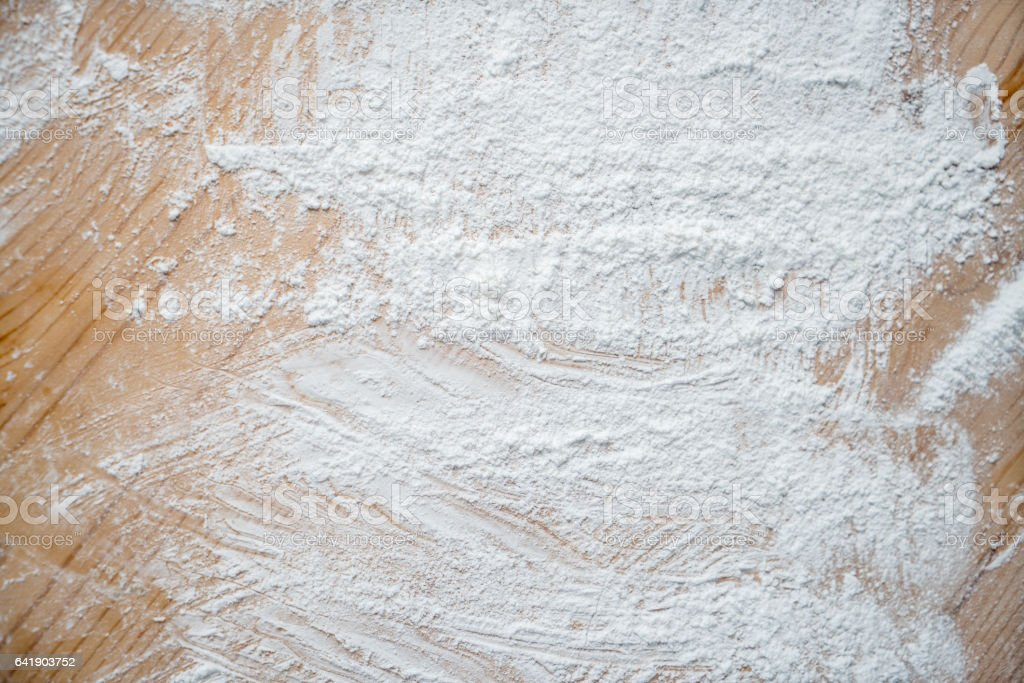 Wooden surface covered in flour stock photo