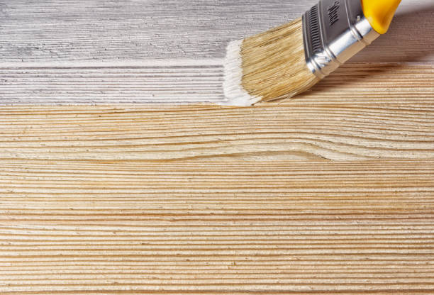 Wooden surface of the painted paint brush stock photo