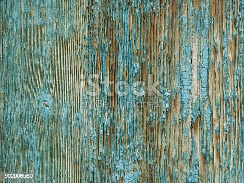 wooden surface with old paint peeling off