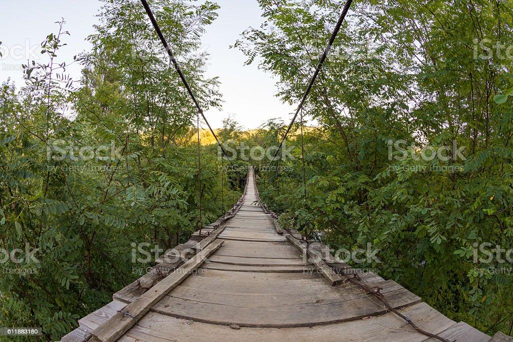 Wooden suspension bridge in Cheile Nerei, Romania stock photo