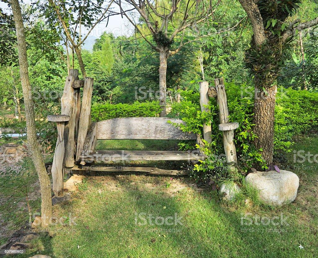 wooden swing in the garden stock photo