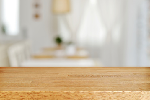 Wooden table and blurred dining room