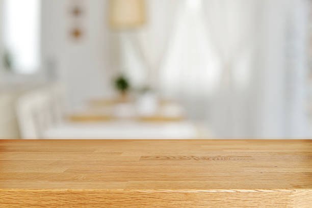 Wooden table and blurred dining room stock photo