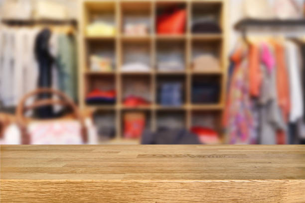 Wooden table and blurred retail display stock photo
