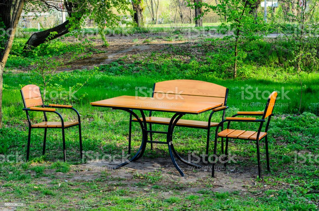 Wooden table and chairs outdoor zbiór zdjęć royalty-free