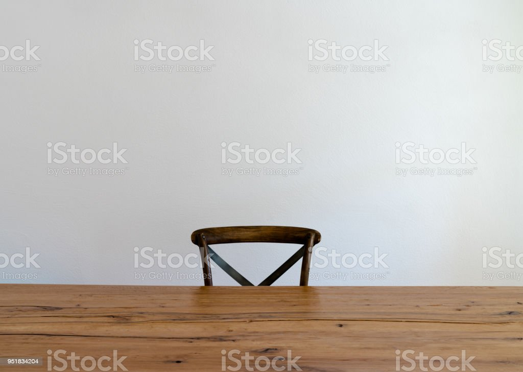 wooden table and one empty chair stock photo