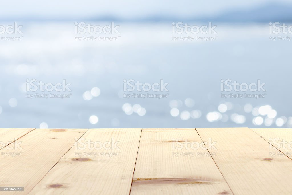 wooden table and sea blur background stock photo