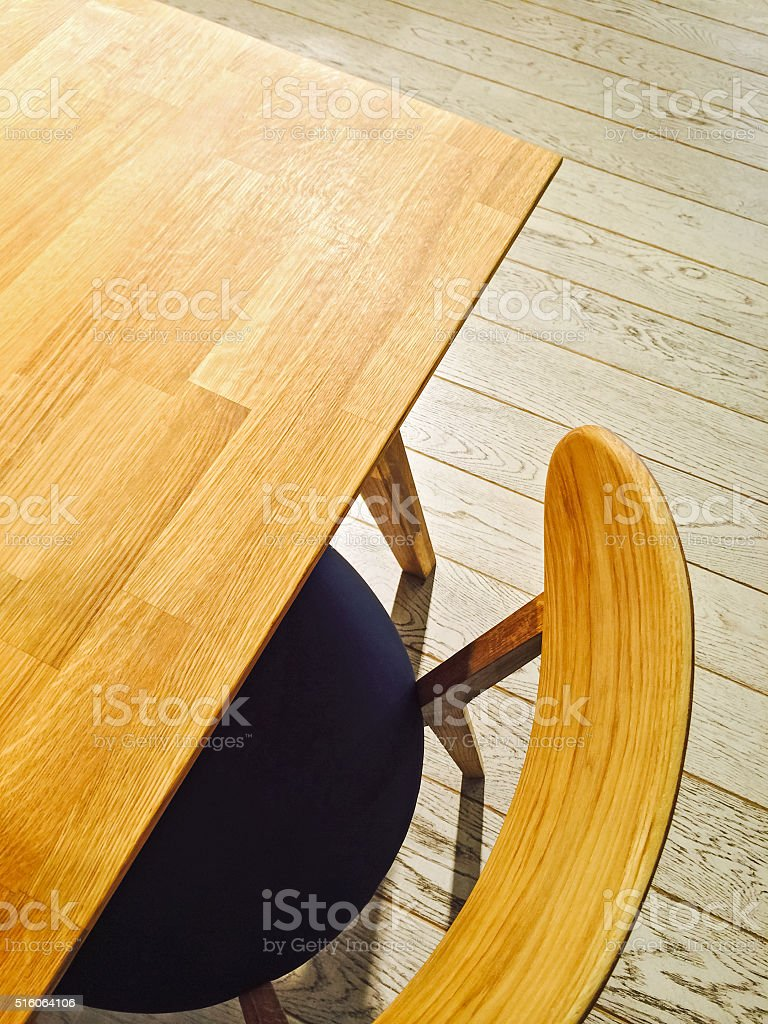 Wooden table and stylish chair stock photo