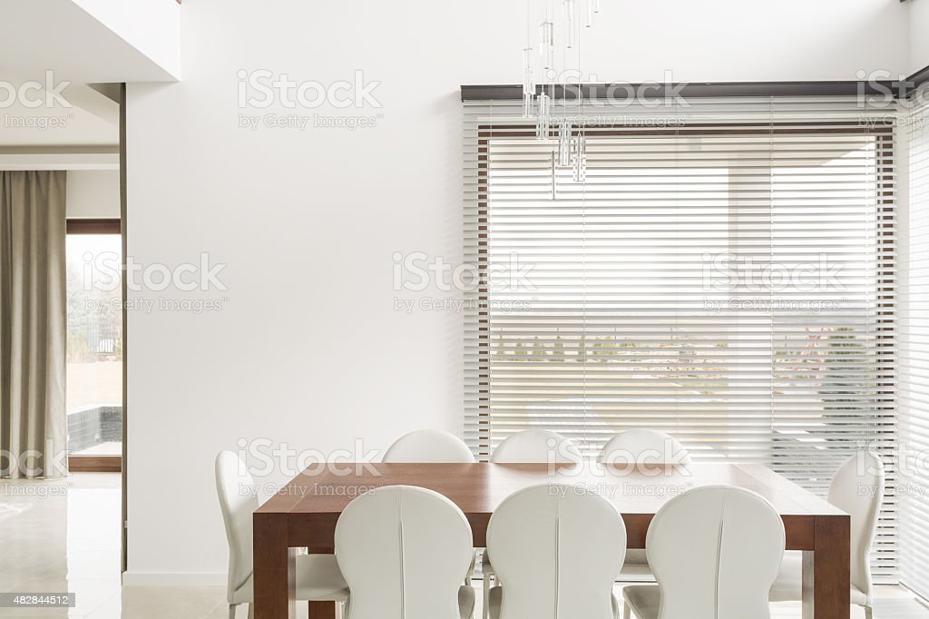 Wooden table and white chairs stock photo
